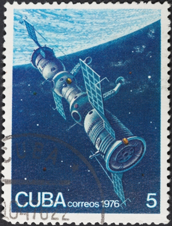 orbital: CUBA - CIRCA 1976: A postage stamp printed in the Cuba shows docked space station Mir and Soyuz spacecraft in Earth orbit, circa 1976 Editorial