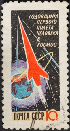 manned: USSR - CIRCA 1961: A postage stamp printed in the USSR shows launch of carrier rocket Vostok - anniversary of the first manned space flight, circa 1961