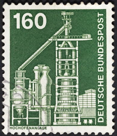 FEDERAL REPUBLIC OF GERMANY - CIRCA 1975: A postage stamp printed in the Germany shows industrial blast furnace plant, circa 1975
