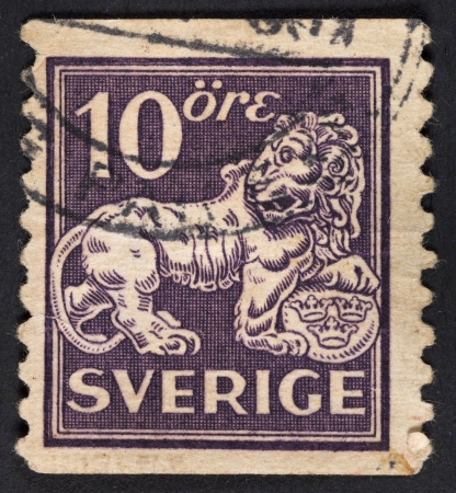 SWEDEN - CIRCA 1925: A postage stamp printed in the Sweden shows symbol of swedish monarchy lion, circa 1925