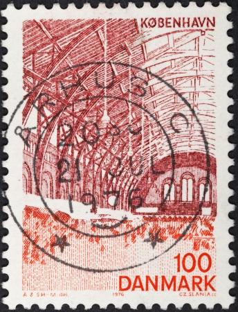 DENMARK - CIRCA 1976: A postage stamp printed in the Denmark shows interior of train station in Copenhagen, circa 1976