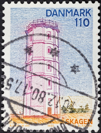 DENMARK - CIRCA 1980: A postage stamp printed in the Denmark shows The white Lighthouse - Denmarks first lighthouse made of bricks in Skagen, circa 1980