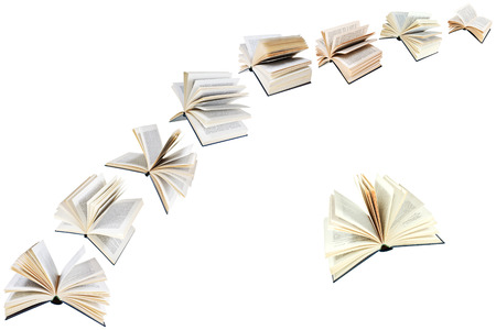 illusory: arco de libros vuelo aislados en el fondo blanco Foto de archivo