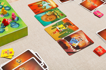 spiel: MOSCOW, RUSSIA - FEBRUARY 3, 2014: Dixit card game created by Jean-Louis Roubira in 2008, and published by Libellud. In 2010 the game received prestigious award Spiel des Jahres (Game of the Year)