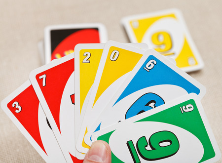 MOSCOW, RUSSIA - FEBRUARY 3, 2014: Uno card game played with specially printed deck. The game was developed by Merle Robbins in USA in 1971, and it has been Mattel product since 1992