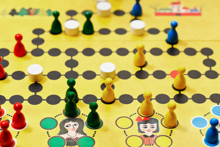 spiel: MOSCOW, RUSSIA - FEBRUARY 3, 2014: Malefiz - family board game close up. It was designed by Werner Schoppner and published by Ravensburger since 1959
