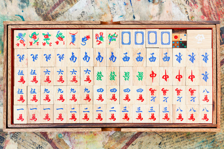 mahjong: set of wooden mahjong tiles in box on table