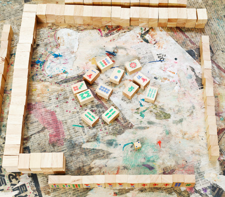 playing field of mahjong board game on shabby table photo
