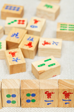 wood tiles closeup in mahjong game durung playing on textile table photo