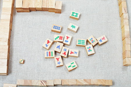 top view of playing field of mahjong board game on textile table photo