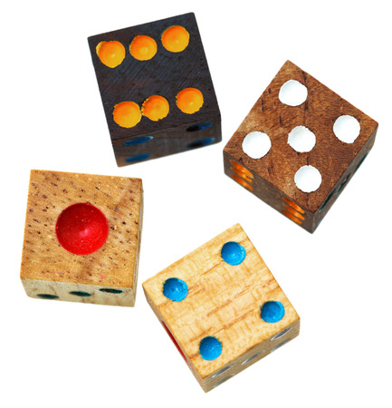 four wooden gambling dices close up isolated on white background photo