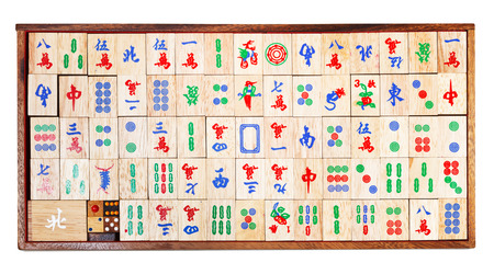 top view of set of wooden mahjong game tiles in box isolated on white background