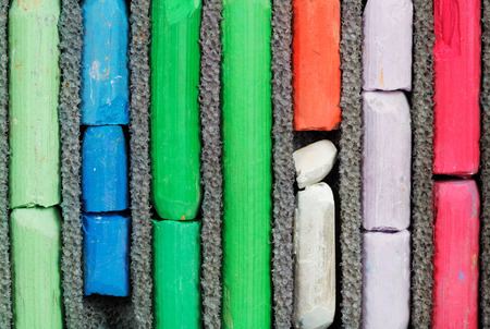 set of many-coloured used artistic dry pastel close up