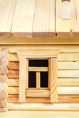 close up chimney: window of model of simple village wooden log house isolated on white background