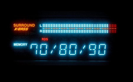 blue scale of sound volume on illuminated indicator board of radio receiver close up photo
