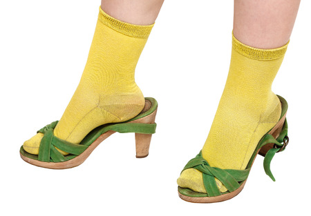 little girl trying on green sandals older sister photo