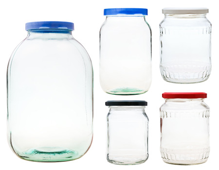 preserving: set of closed glass jars isolated on white background