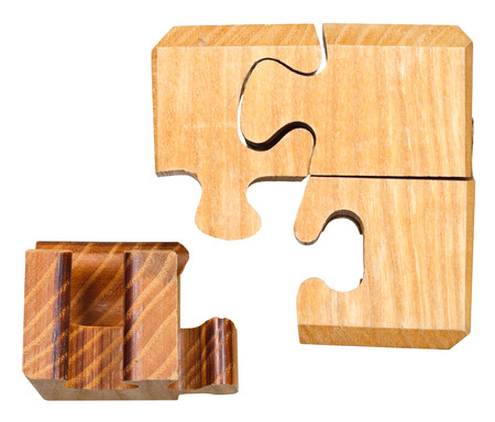 blocks of three dimensional wooden mechanical puzzle close up isolated on white background isolated on white background Stock Photo