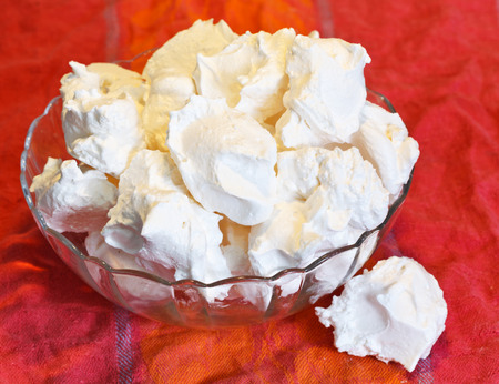 meringue sweet dessert from whipped egg whites and sugar in glass bowl Stock Photo