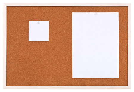 two sheets of paper on bulletin cork board isolated on white background photo