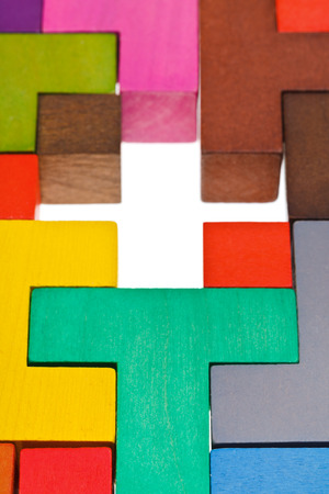 cross shape hole in wooden multicoloured puzzle photo
