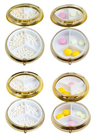 pilule: scatole di pillola compatto con specchio e zucchero palle omeopatia e compresse isolato su sfondo bianco