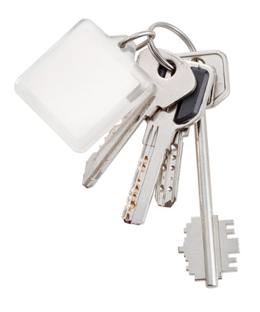 bunch of home keys on steel ring and keychain isolated on white background - 2