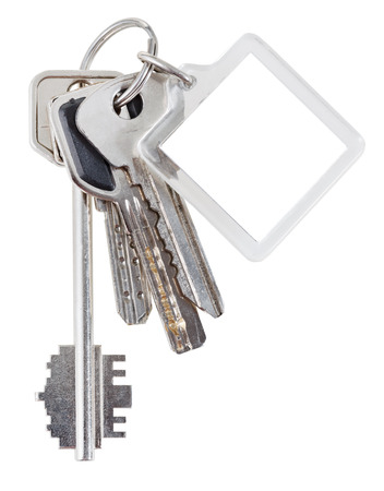 trinket: bunch of house keys on steel ring and keychain isolated on white background