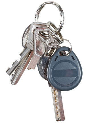 bunch of keys on steel ring and magnetic key isolated on white background photo