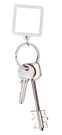 two keys and square keychain on ring isolated on white background photo