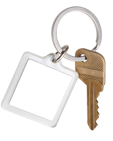 one house brass key and square keychain on ring isolated on white background photo