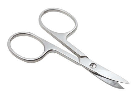 pair of manicure nail scissors isolated on white background photo