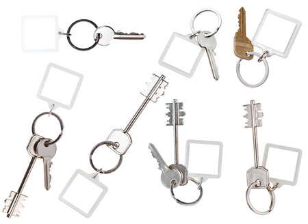 trinket: collection of keys on ring with blank keychain isolated on white background Stock Photo