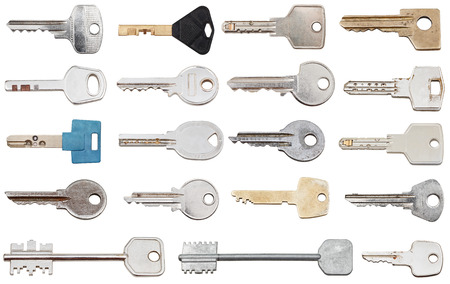 set of different door keys isolated on white background photo