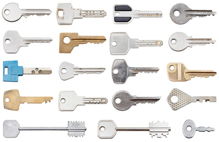 collection of different house keys isolated on white background photo