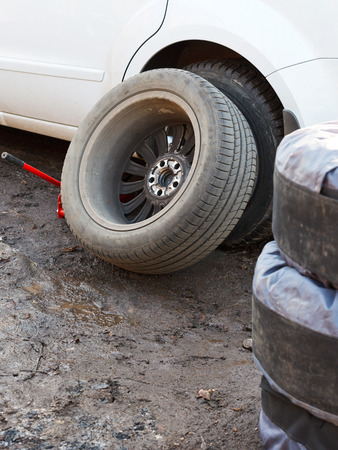tire fitting: seasonal replacement of car tyres outdoors - car tire fitting