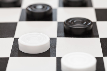 draughts on black and white vinyl board close up photo