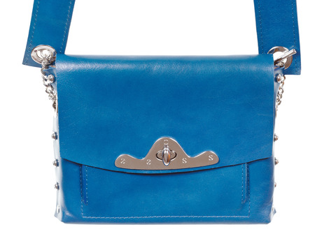 pochette: blue leather ladies bag close up isolated on white