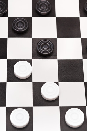 above view of playing position on black and white draughts board photo