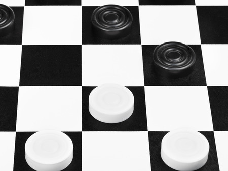 draughts game on black and white board close up photo