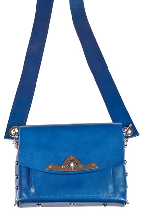 pochette: flat blue leather ladies bag with wide belt isolated on white