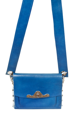 pochette: flat blue leather female bag with broad belt isolated on white