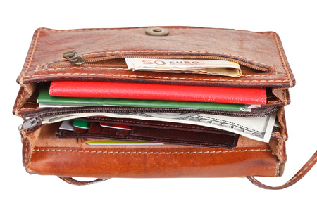 pochette: cash, credit cards, documents in small open female handbag isolated on white
