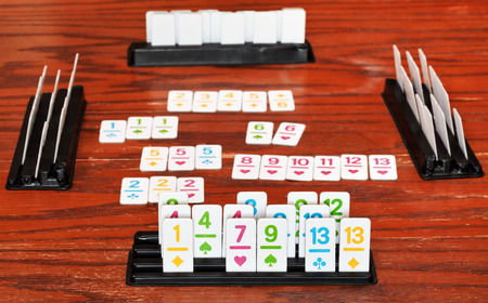 rummy: set of tiles in rack during playing in rummy game on wooden board