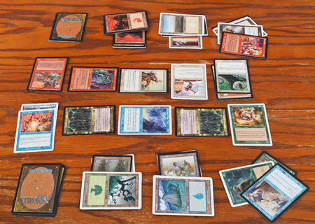 MOSCOW, RUSSIA - MARCH 24, 2013: gameplay of card game Magic: The Gathering. The game was created by Richard Garfield and first published in 1993 by Wizards of the Coast.