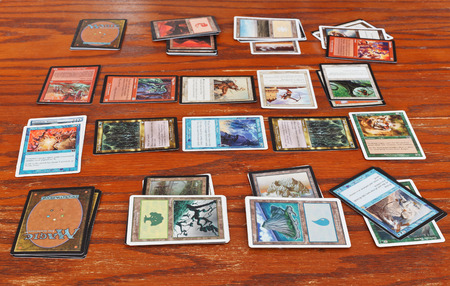 MOSCOW, RUSSIA - MARCH 24, 2013: wizards battle in card game Magic: The Gathering. The game was created by Richard Garfield and first published in 1993 by Wizards of the Coast.