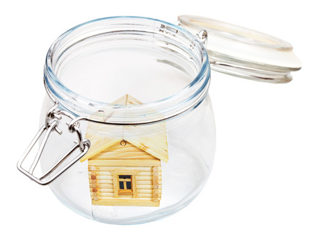 new wood house in open glass jar