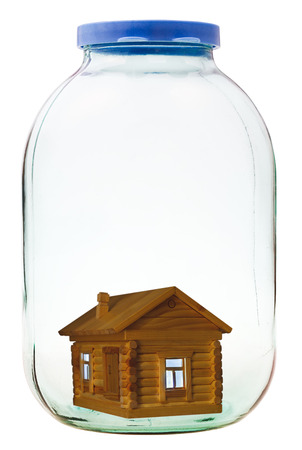 rural wooden house in closed glass jar