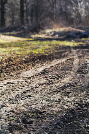 wheeled tractor: wheeled tractor tracks in dirt country road in spring