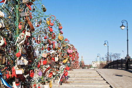 honeymooner: Love Tree with honeymooner padlocks on Luzhkov bridge in spring, Moscow Editorial